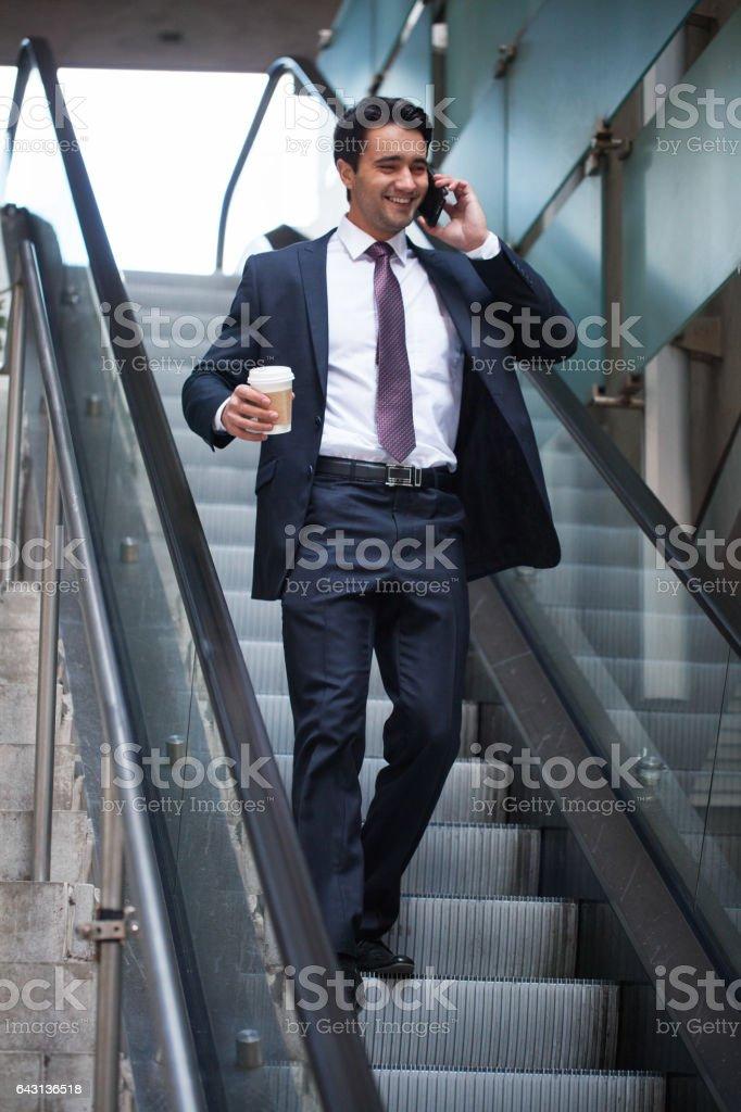 Happy businessman talking on phone stock photo
