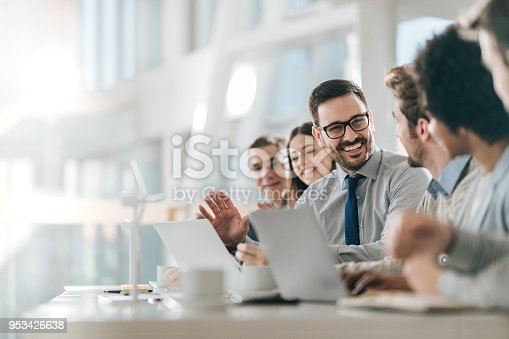 istock Happy businessman talking to his colleagues on a meeting in the office, 953426638