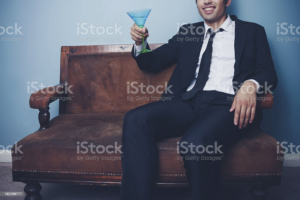 Happy businessman toasting royalty-free stock photo