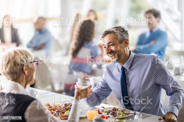 Happy businessman toasting with his colleague on a lunch in cafeteria picture id1097790778?b=1&k=6&m=1097790778&s=612x612&h=pvhtsbimkulcbl114p8ibktj5tdhuaqiyfssembqeng=