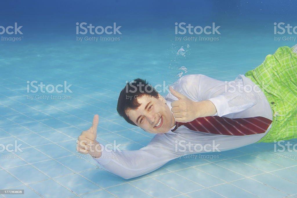 Happy businessman underwater royalty-free stock photo