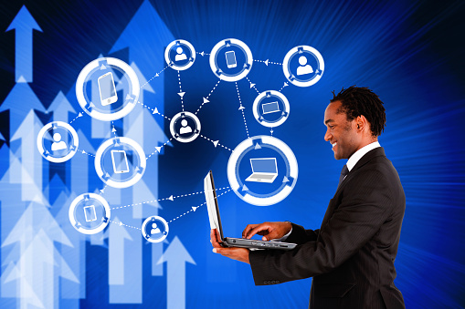 istock Happy businessman using laptop with device and profile icons 496238165