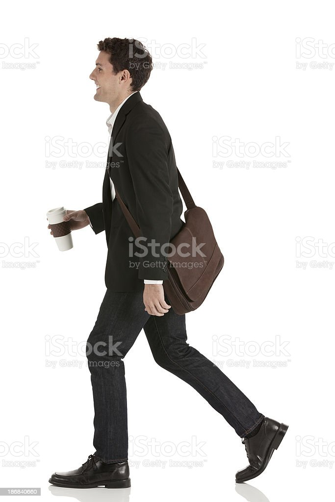 Happy businessman walking with coffee royalty-free stock photo