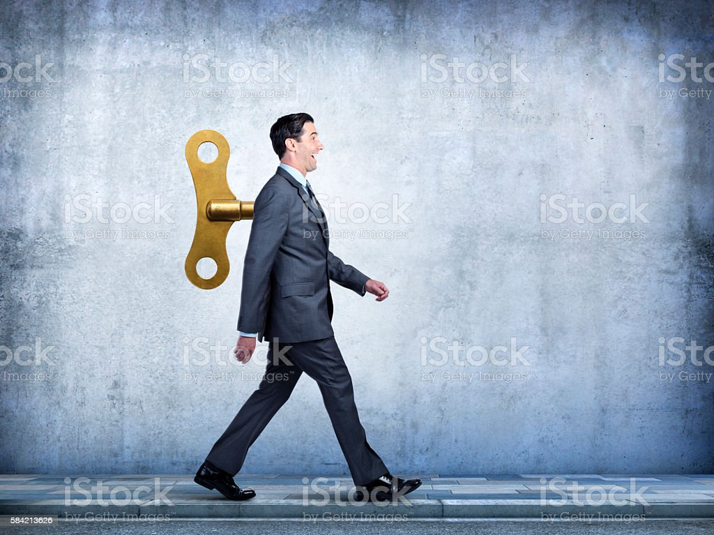 Happy Businessman Walking With Wind Up Key In His Back – Foto
