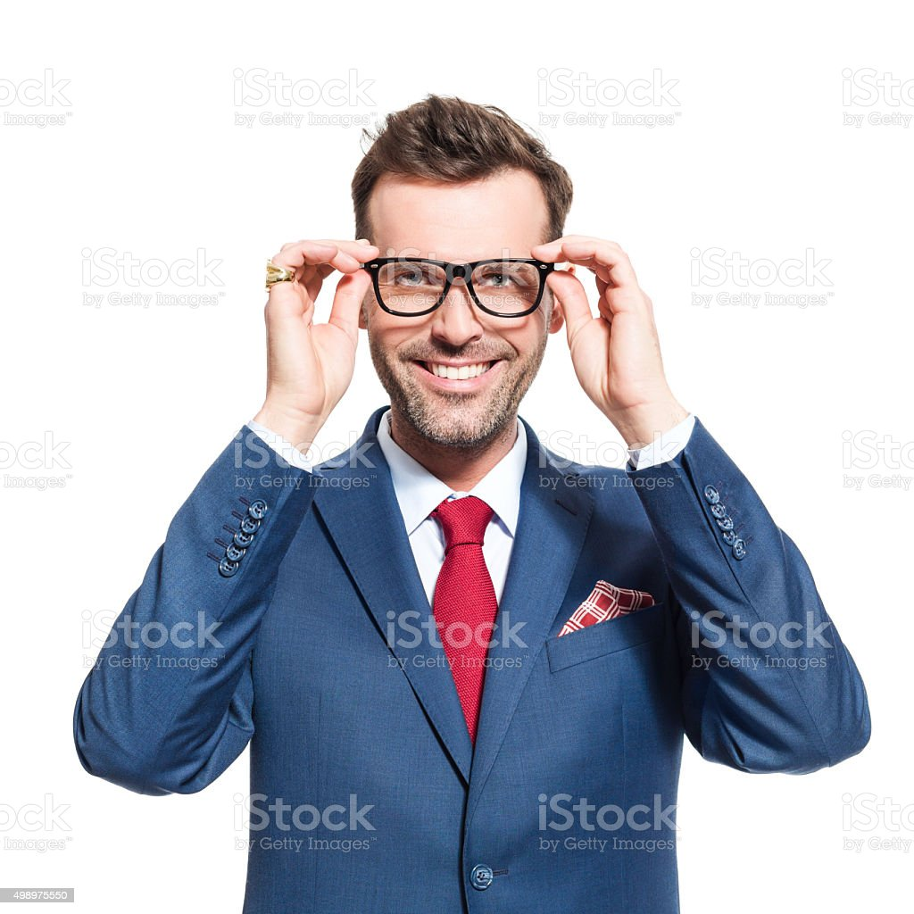 Happy businessman wearing suit and nerd glasses Portrait of elegant businessman wearing suit and nerd glasses, smiling at camera. Studio shot, one person, isolated on white. 2015 Stock Photo