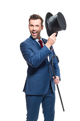 Happy Businessman Wearing Suit Holding Cylinder Hat And Walkign Cane Stock Photo - Download Image Now