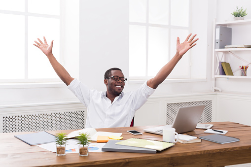 istock Happy businessman win. Winner, black man in office 814347448