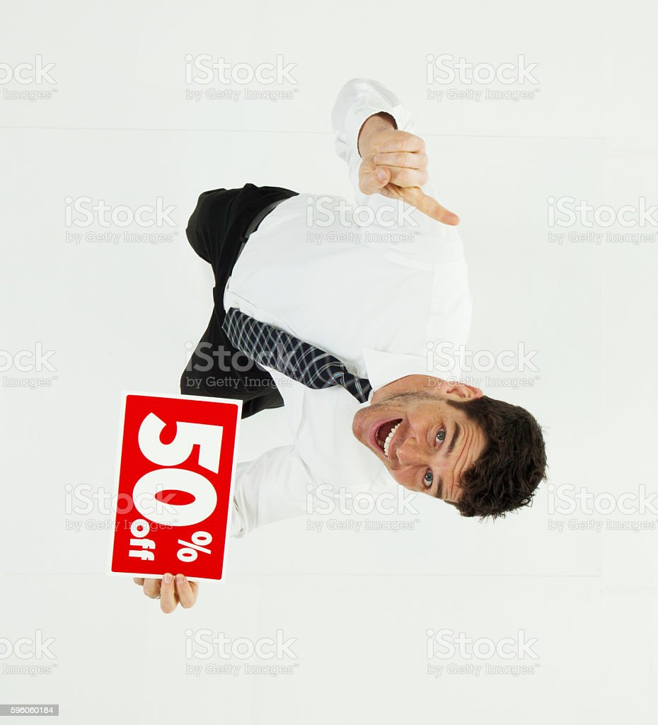 Happy businessman with 50% off sign and pointing royalty-free stock photo