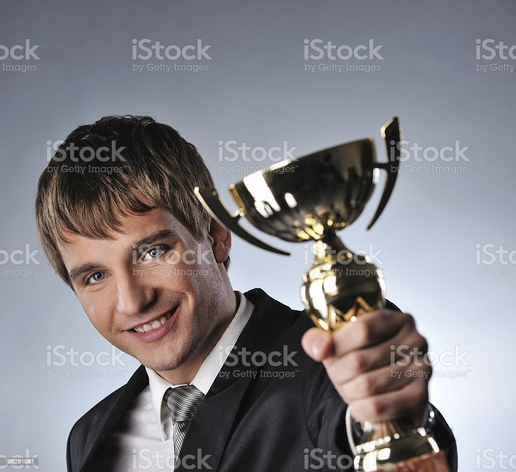 Happy businessman with a golden cup royalty-free stock photo