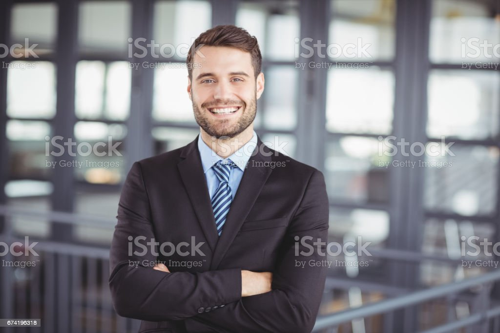 Happy businessman with arms crossed stock photo