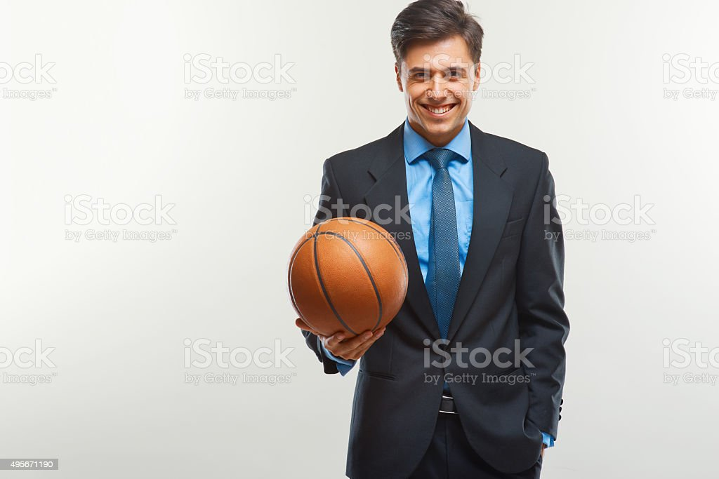 Happy Businessman with  ball against white background stock photo