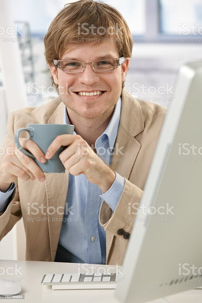 Happy businessman with coffee royalty-free stock photo