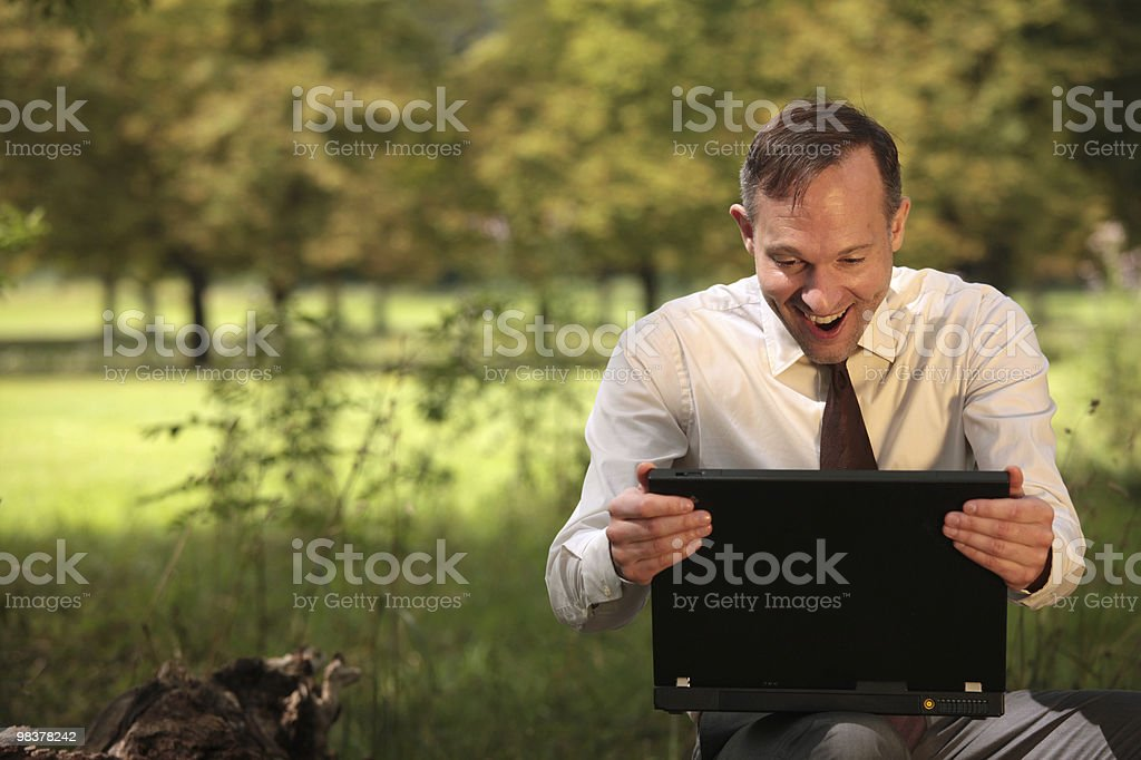 happy businessman with laptop royalty-free stock photo