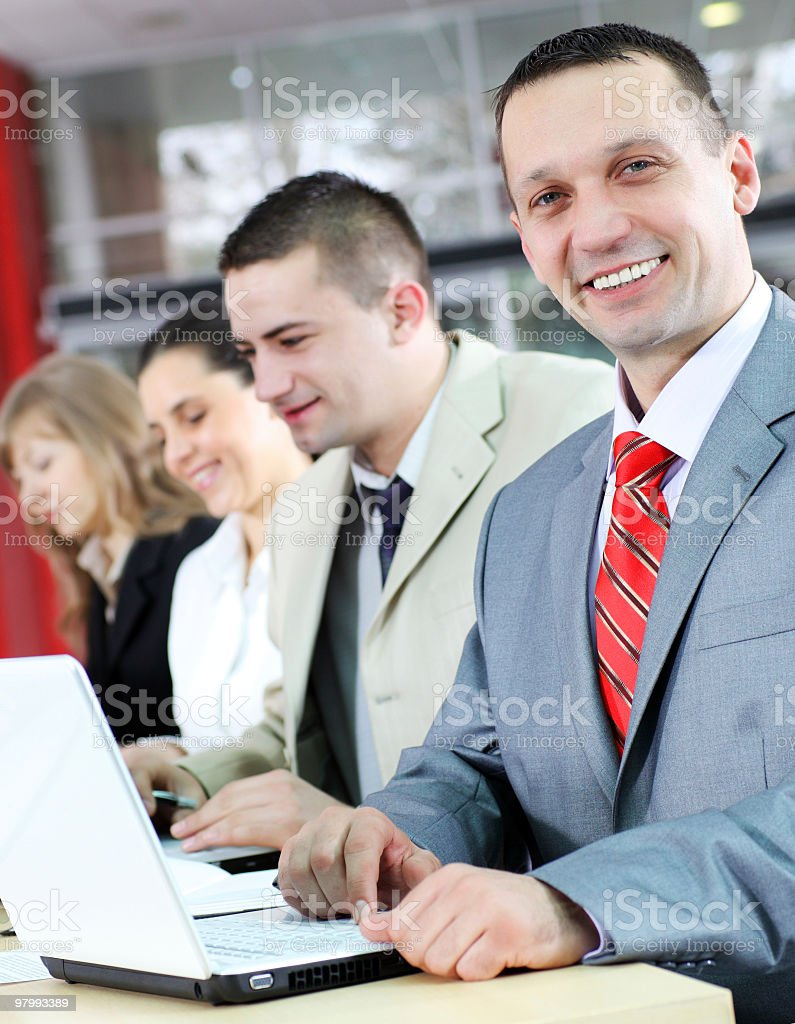 Happy businessman with team behind his. royalty-free stock photo