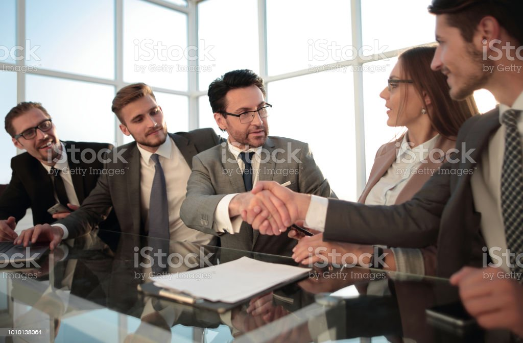 happy businessmen, handshake after the negotiations stock photo