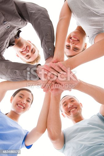 istock Happy businesspeople placing their hands top of each other 483486570