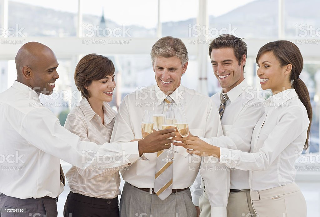 Happy businesspeople toasting champagne glasses royalty-free stock photo