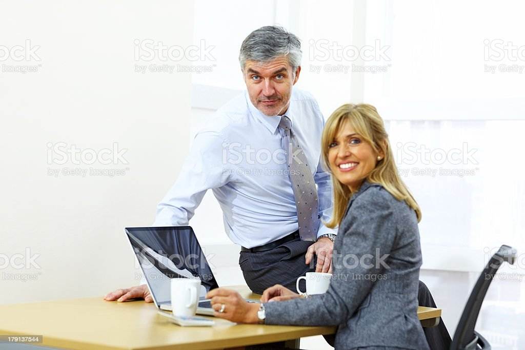 Happy businesspeople together at work royalty-free stock photo