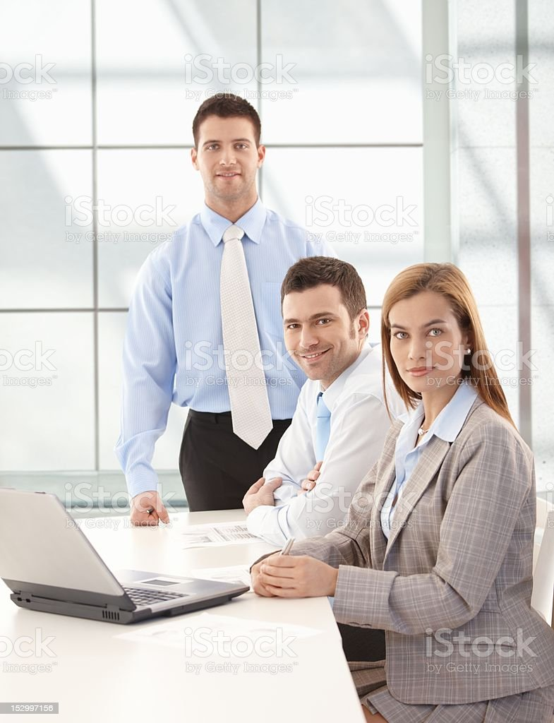 Happy businessteam working together smiling royalty-free stock photo