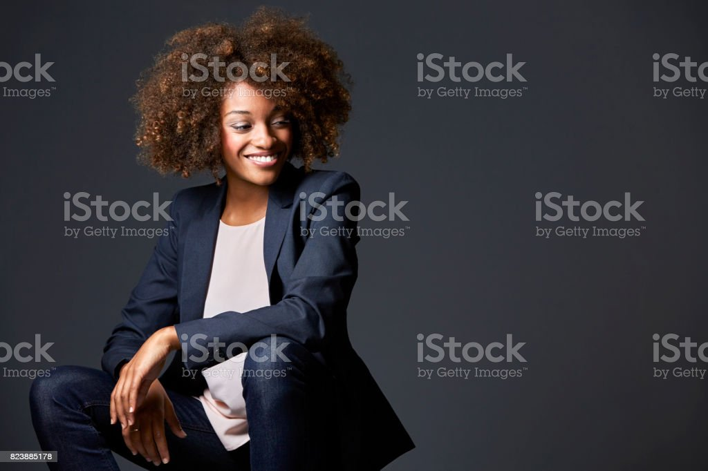 Happy businesswoman against gray background stock photo