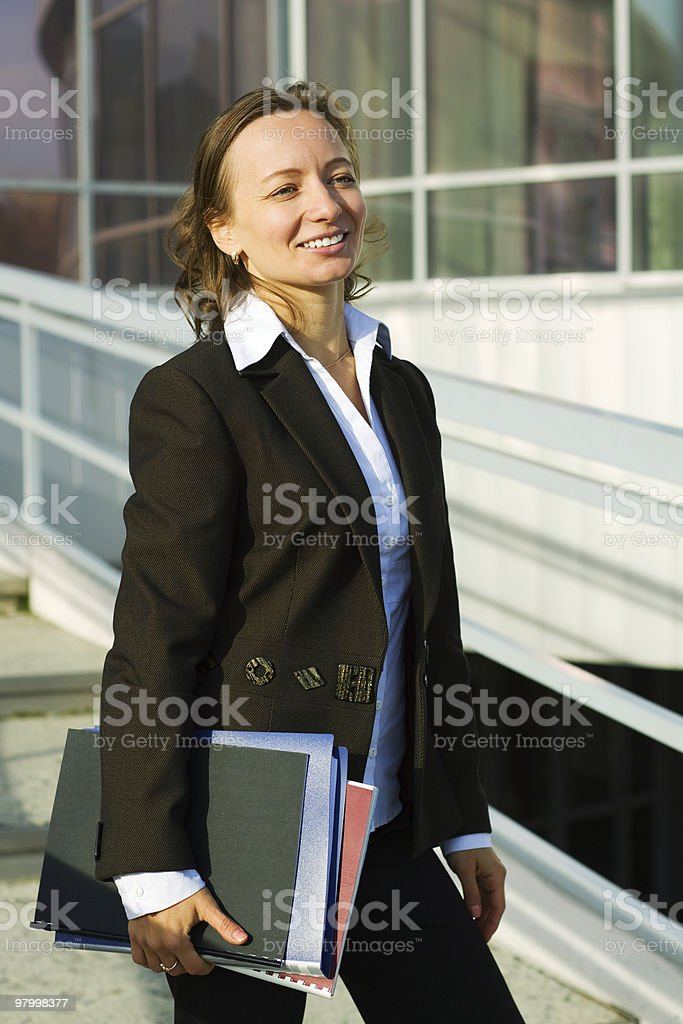 Happy businesswoman at the airport royalty-free stock photo