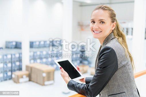 istock Happy businesswoman at warehouse 953820488