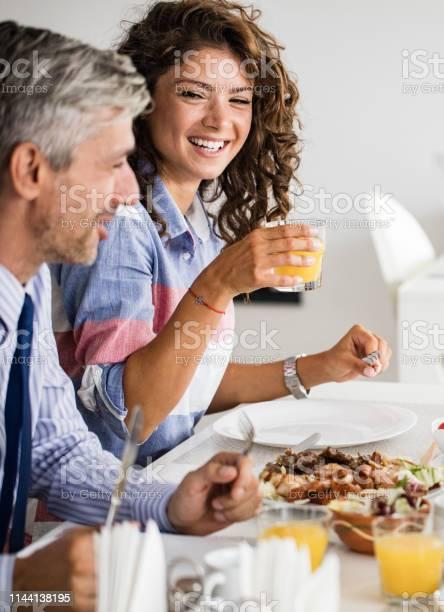 Happy businesswoman enjoying on a lunch with her colleague picture id1144138195?b=1&k=6&m=1144138195&s=612x612&h=2o3b r ui6kqz8gsaosmxxota10ijyzljj08stbnglw=