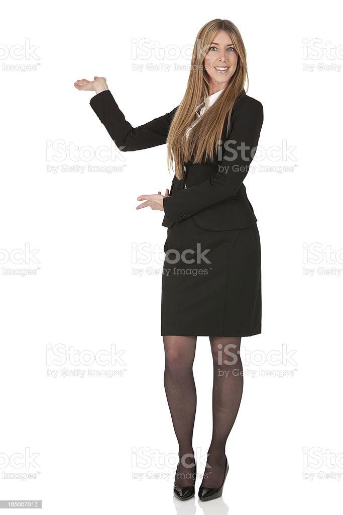 Happy businesswoman gesturing royalty-free stock photo