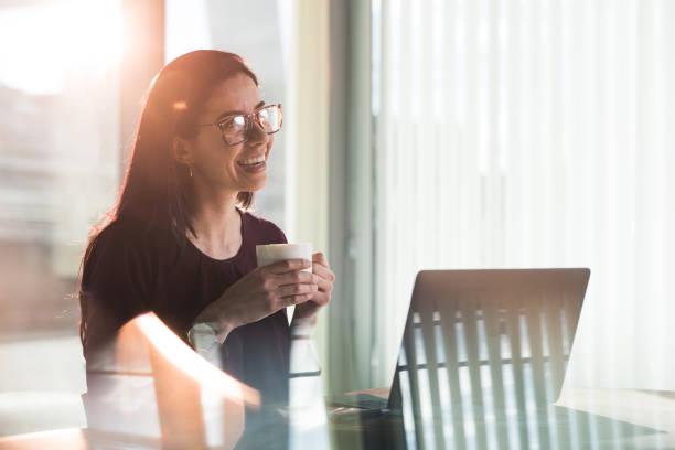 happy businesswoman having meeting via skype. - skype imagens e fotografias de stock