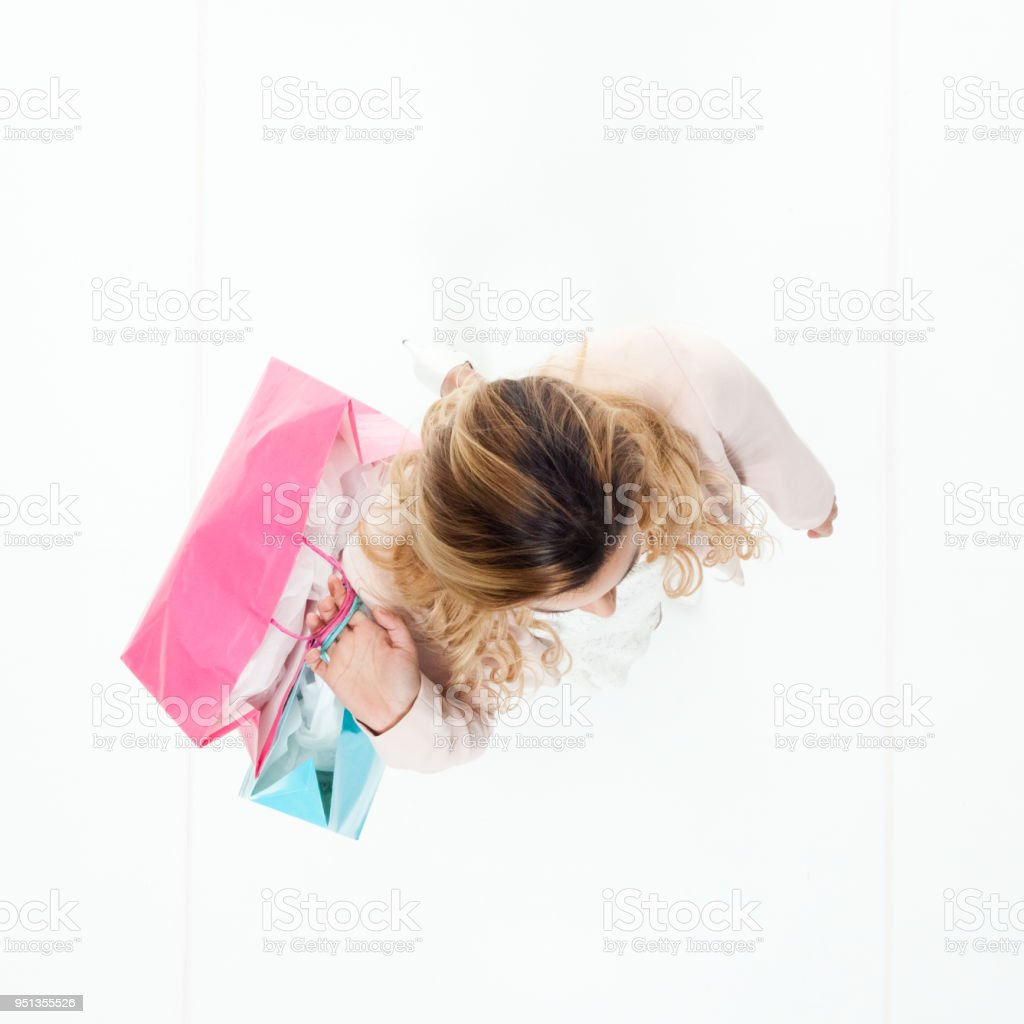 Happy businesswoman holding shopping bags stock photo