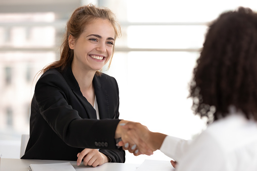 istock Happy businesswoman hr manager handshake hire candidate selling insurance services 1151593845