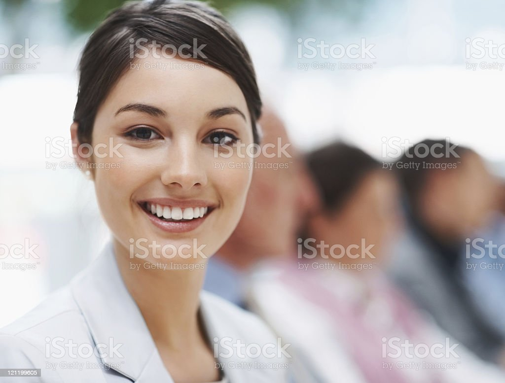 Happy businesswoman in a meeting with colleagues royalty-free stock photo