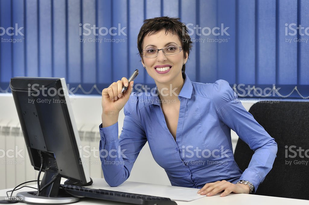 Happy businesswoman in blue royalty-free stock photo