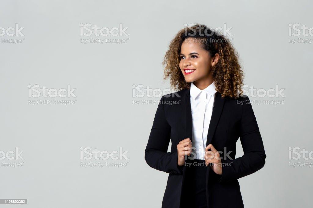Gelukkige zakenvrouw in formele kledij - Royalty-free Afrikaanse etniciteit Stockfoto