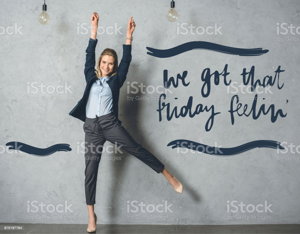happy businesswoman in suit stock photo