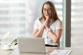 istock Happy businesswoman laughing with joy, gladly looking at laptop screen 828110678
