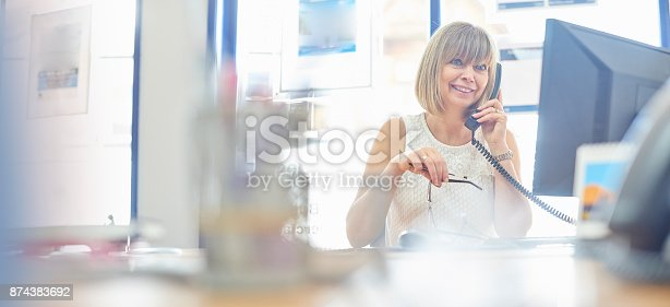 istock Happy businesswoman on the phone 874383692