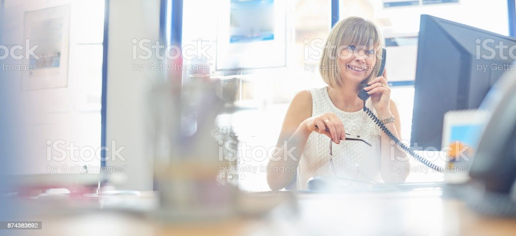 Happy businesswoman on the phone stock photo