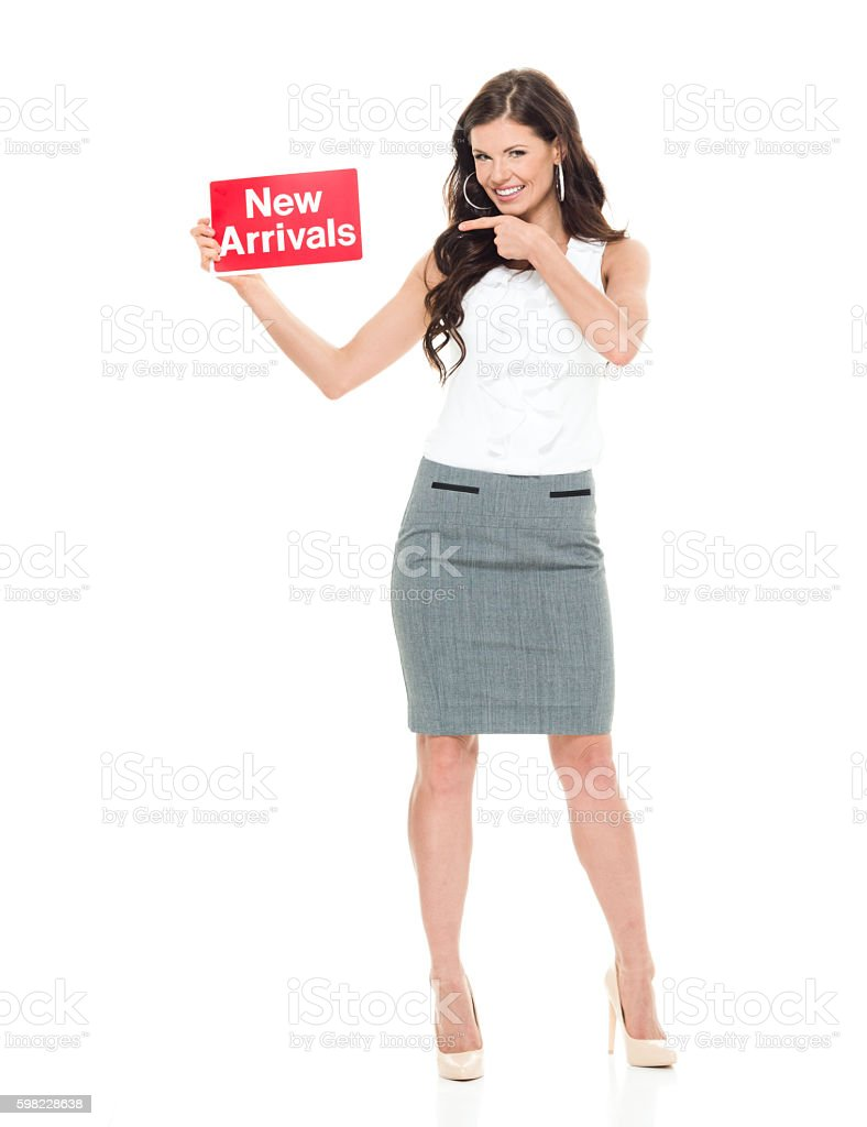 Happy businesswoman pointing at new arrivals sign foto royalty-free