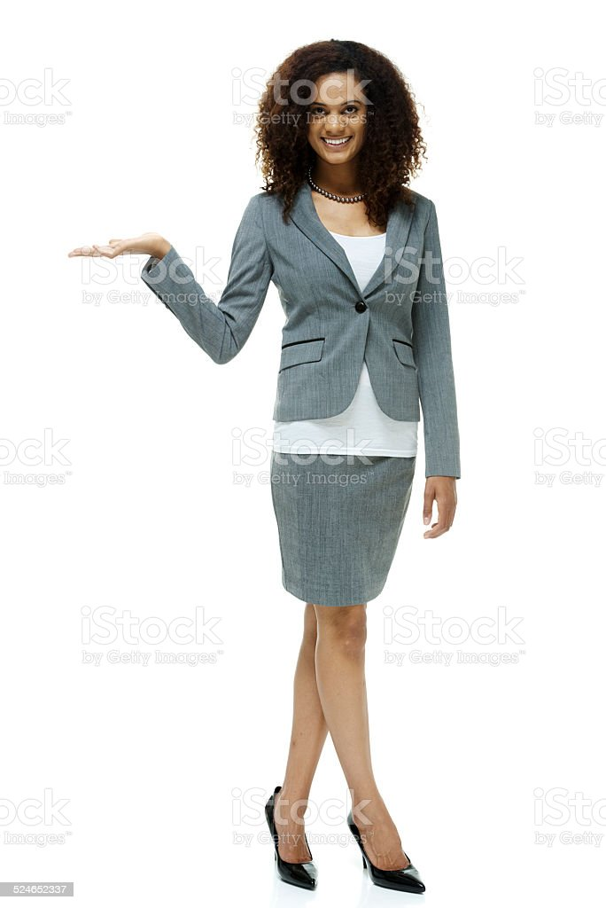 Happy businesswoman presenting stock photo