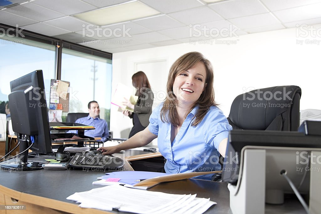 Happy businesswoman reaches for a phone royalty-free stock photo