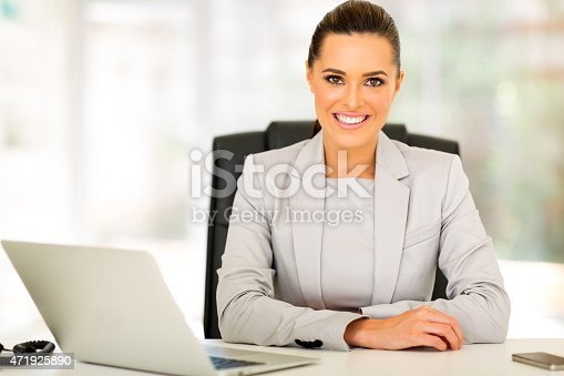 1031394390 istock photo happy businesswoman sitting in office 471925890