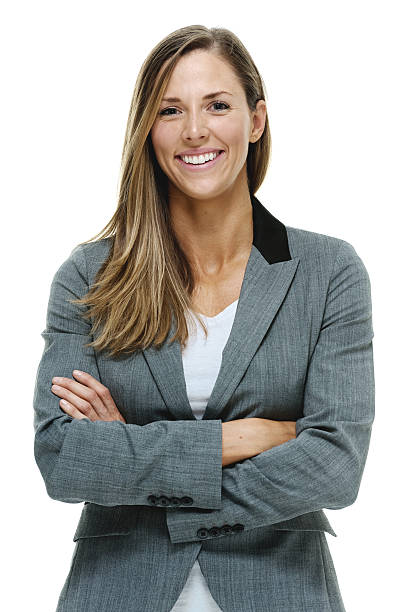 Happy businesswoman standing with arms crossed stock photo