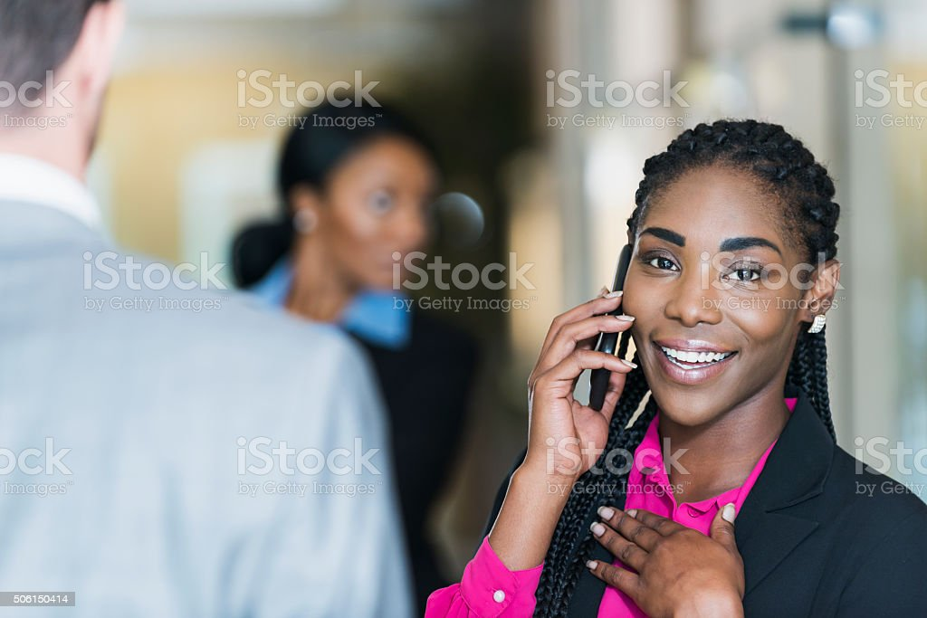 Happy Businesswoman Talking On Mobile Phone In Office Stock