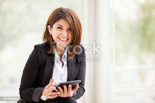 istock Happy businesswoman with a tablet 181800532