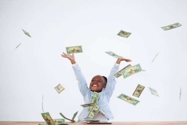 happy businesswoman with arms raised throwing paper currency - throw money away stock pictures, royalty-free photos & images