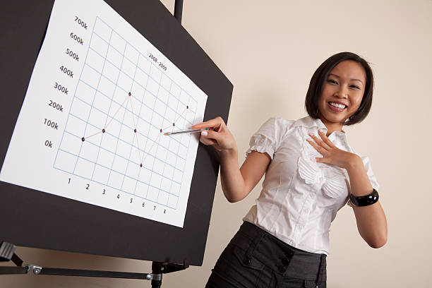 Happy businesswoman with chart stock photo