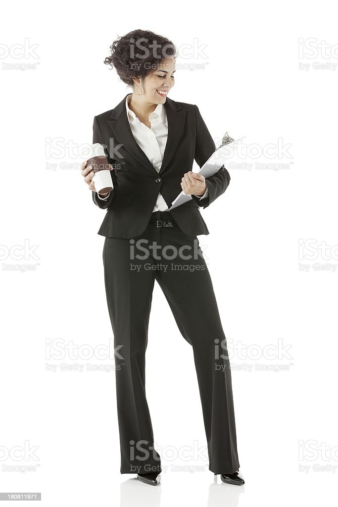 Happy businesswoman with coffee and clipboard royalty-free stock photo