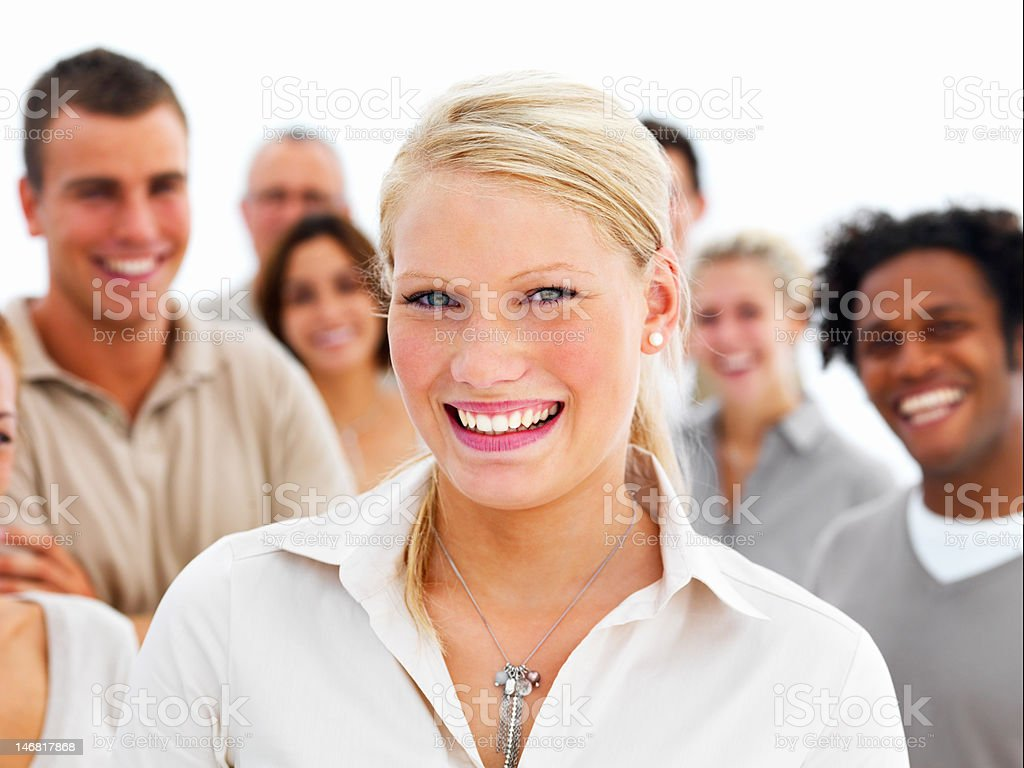 Happy businesswoman with colleagues in background royalty-free stock photo