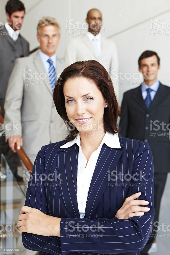 Happy businesswoman with colleagues in the background royalty-free stock photo